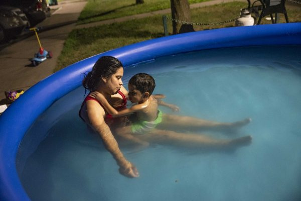 person and child in pool