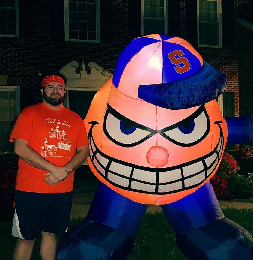 person standing next to Otto balloon