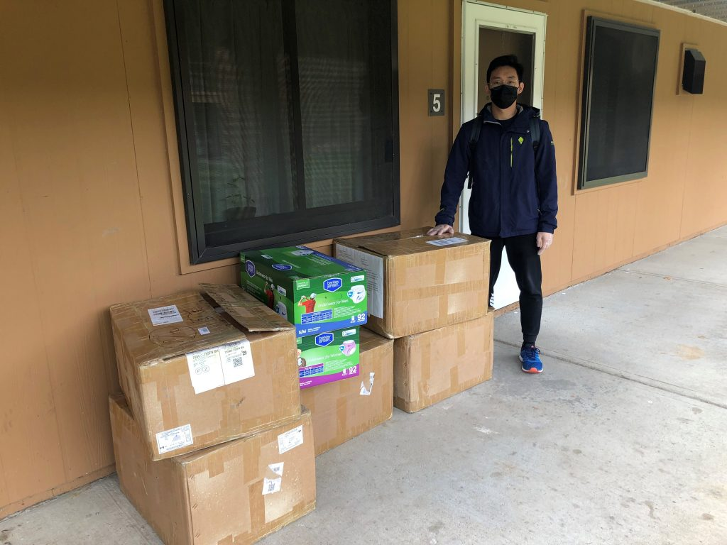 person standing next to boxes