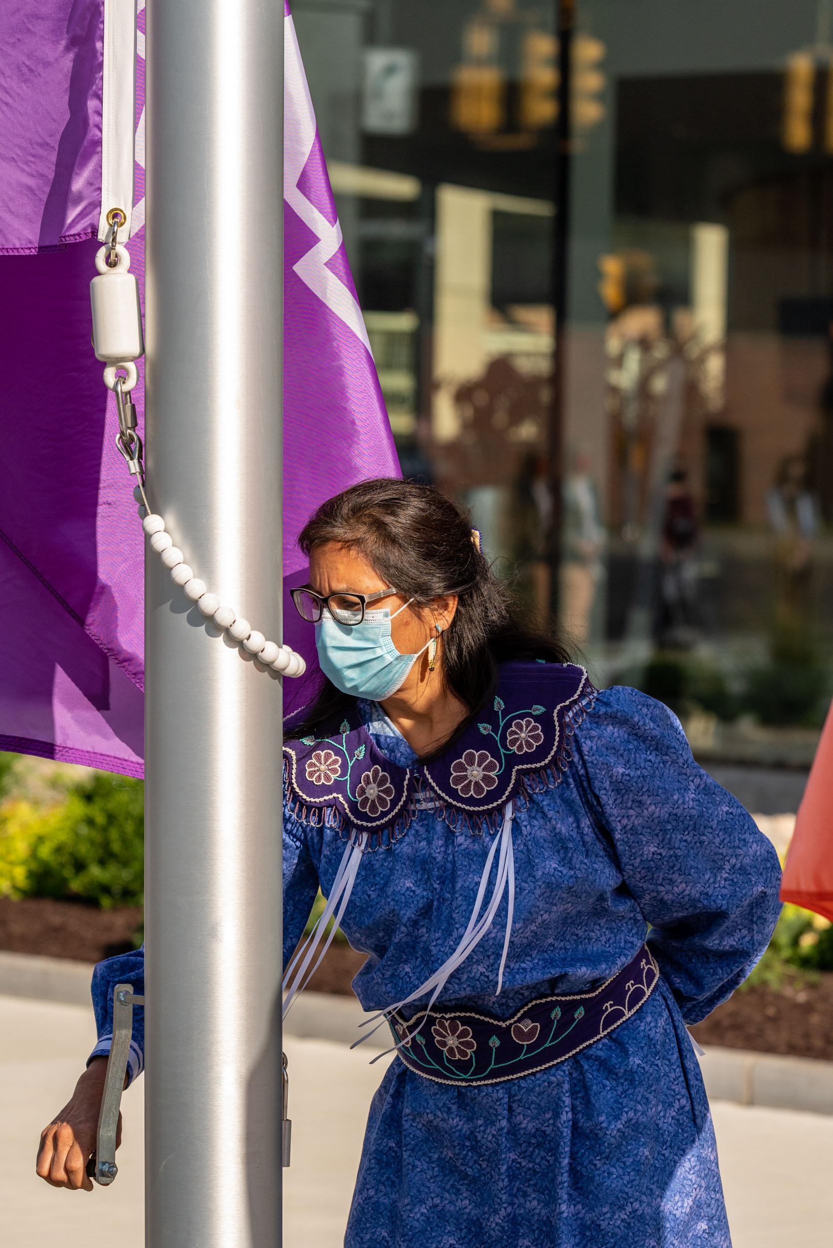 woman raising flag