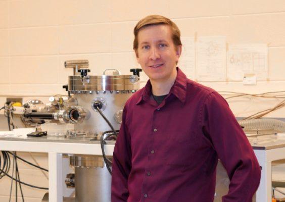 Professor of Physics Britton Plourde poses in his lab