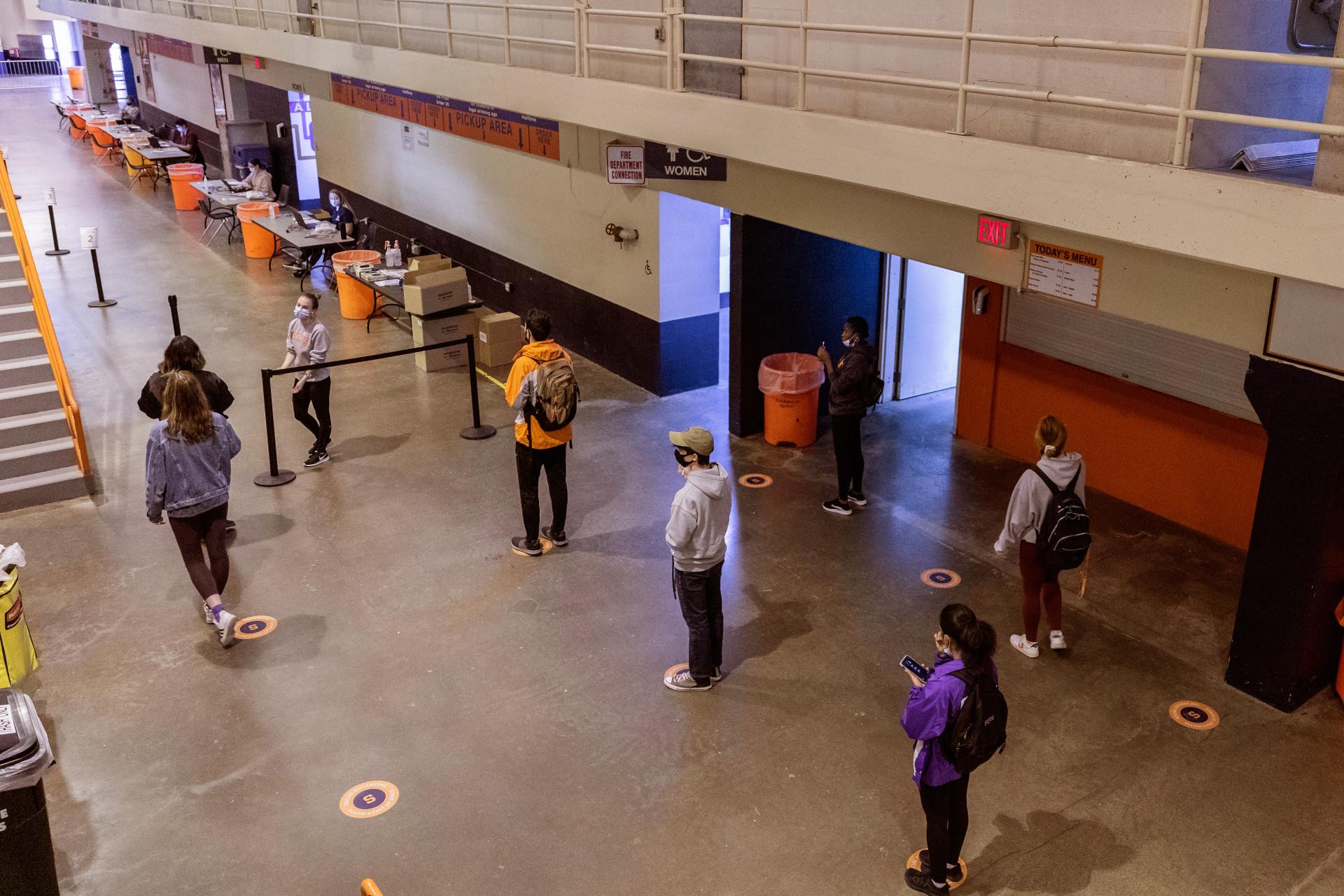 people standing in line for flu shots in Stadium
