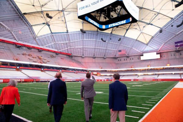 view from behind of five people touring the renovated Stadium