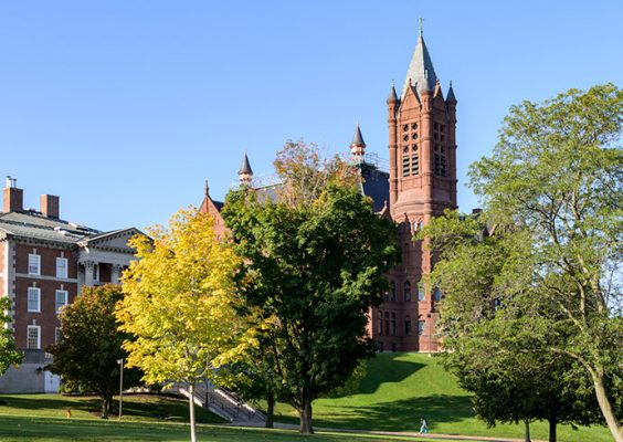 Picture of Crouse College with fall trees in front.