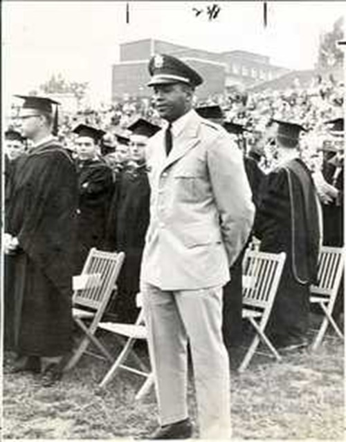 Ernie Davis in uniform standing at graduation