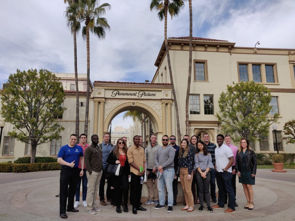 people standing in a group outside Paramount Pictures studio