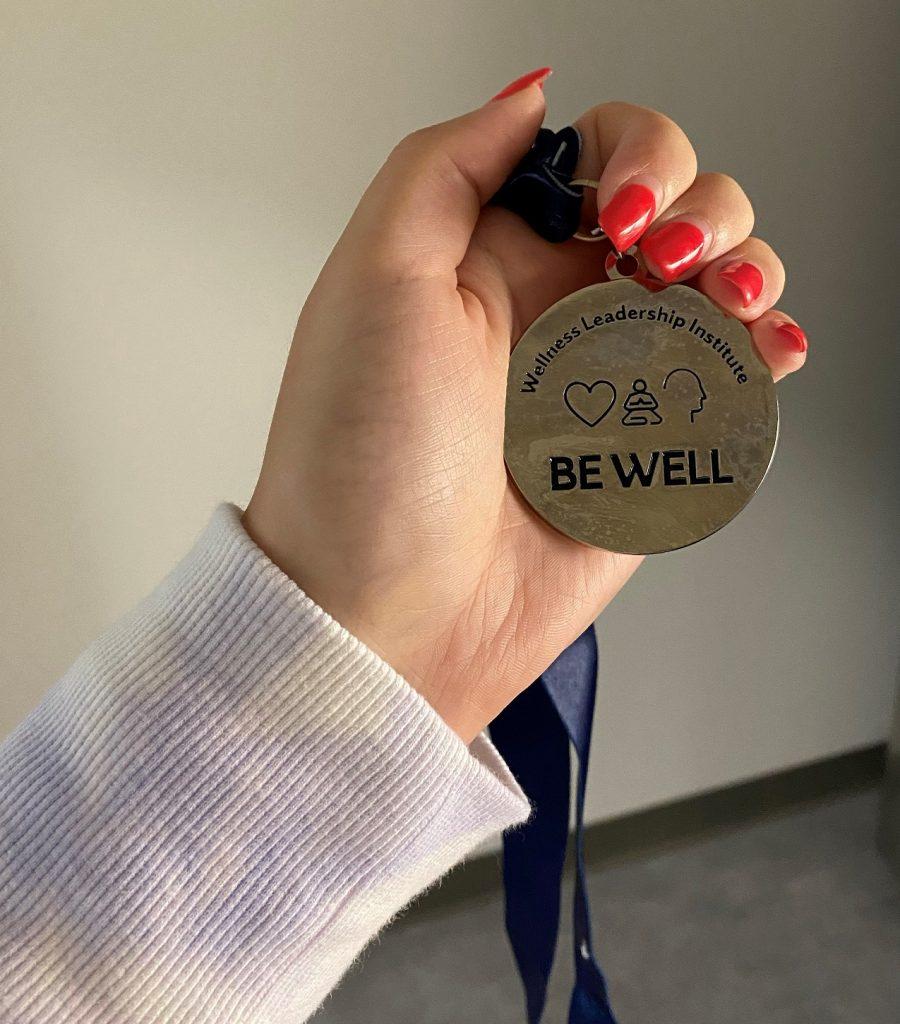 hand holding medallion