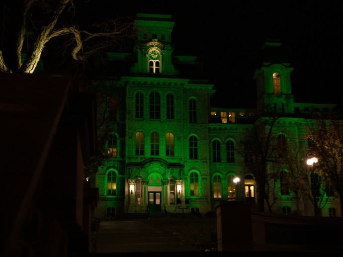 Hall of Languages lit up in green