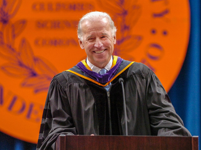 Joe Biden at podium in front of Syracuse University seal
