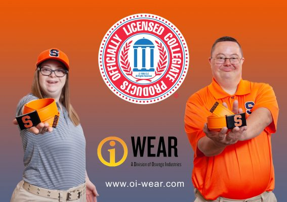 two individuals wearing/holding Syracuse University-branded merchandise