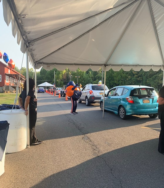 cars lined up under a tent