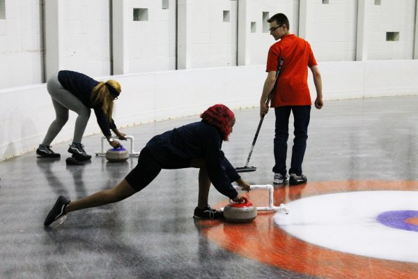 Students curling at the Tennity Ice Skating Pavilion.