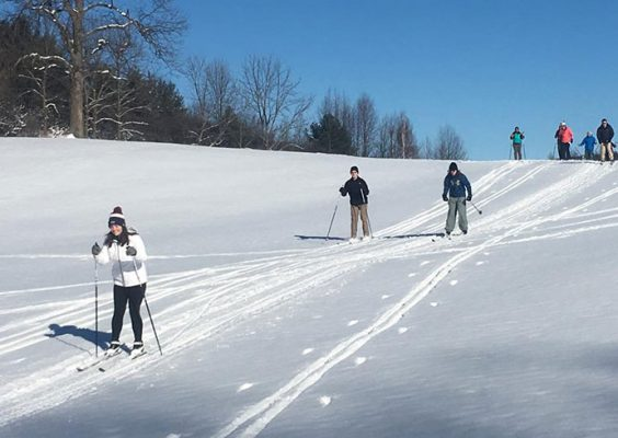 People cross country skiing at Drumlins Country Club