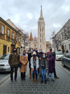 a group of scholars pose in front of the Matthias Church in Budapest, Hungary