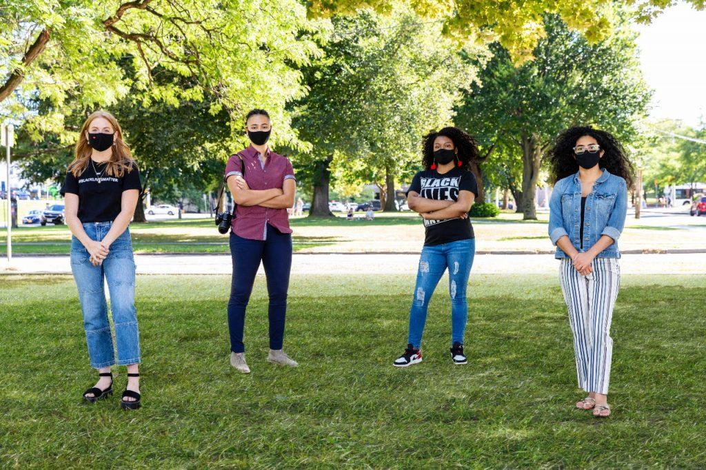 Lender Center student fellows pose outdoors