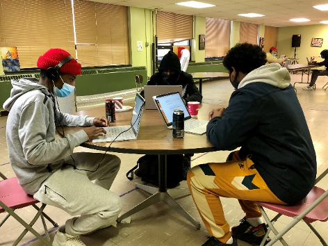 people at a table working on computers