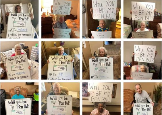 """People holding up """"Willl you be my pen pal?"""" signs"""