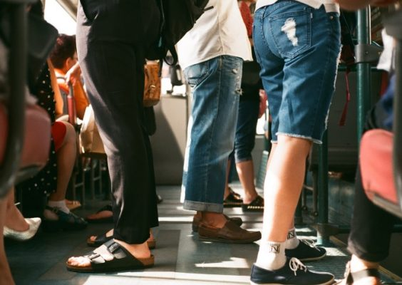 image of legs on a crowded train or subway car