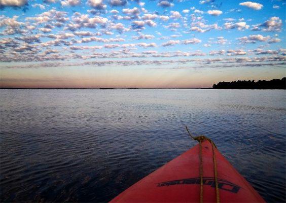 A kayak floats on Oneida Lake