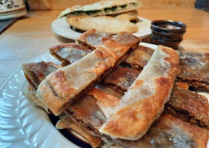 reghaif, a savory pancake filled with ground beef, onions and herbs