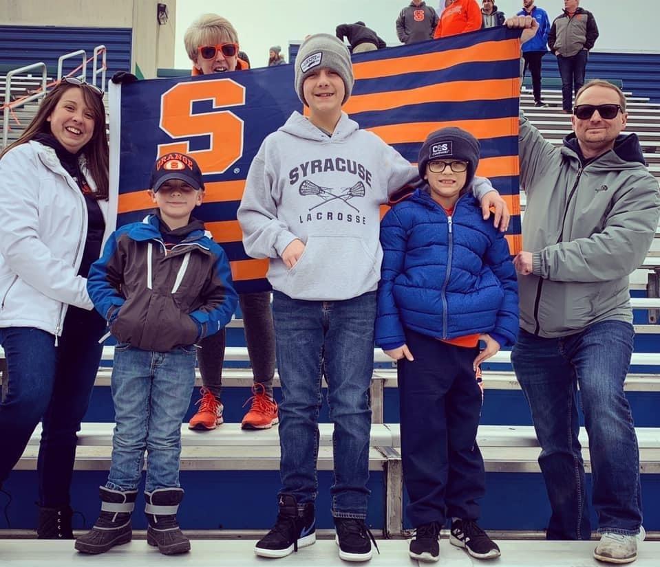 Jamie Oswal and family celebrating a Syracuse win against Duke