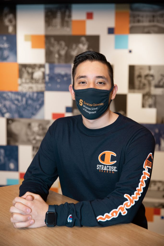 person at table wearing mask