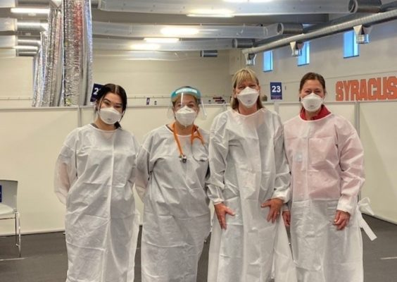 four health care providers in PPE posing