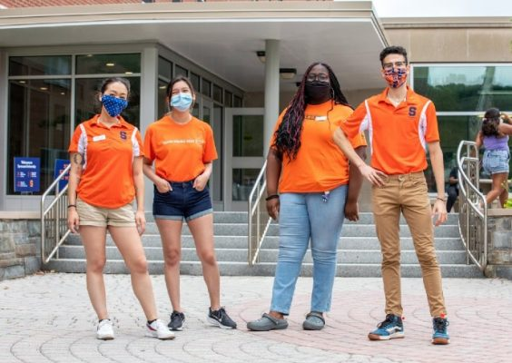 four members of the Fall 2020 Goon Squad pose on campus