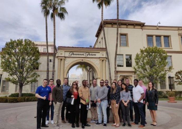people standing in front of Paramount Studios
