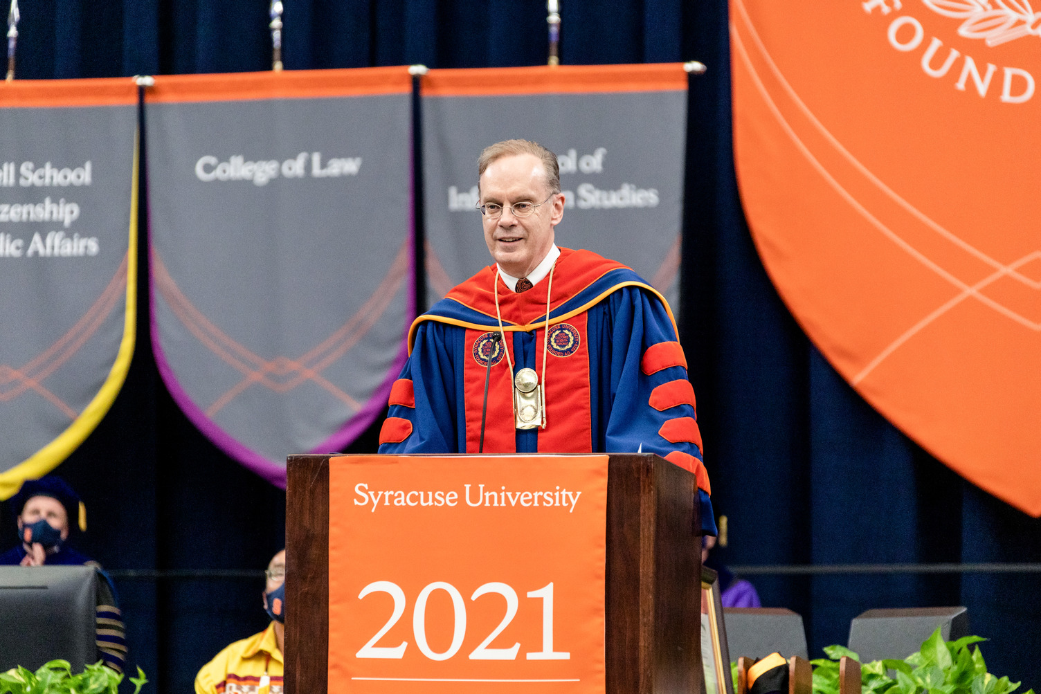 Chancellor Syverud speaks from the podium at Commencement 2021