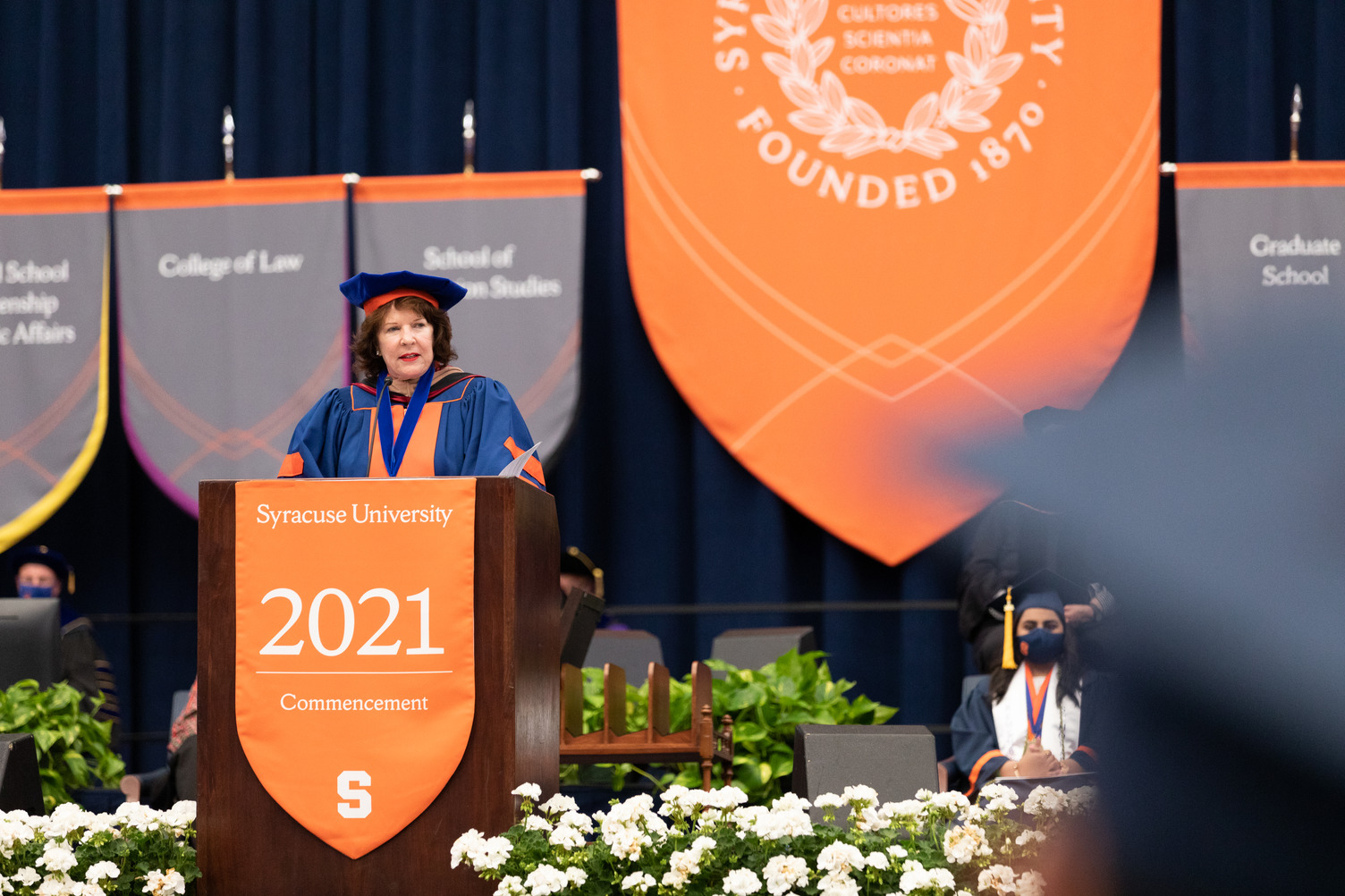Kathy Walters '73, chair of the Board of Trustees, addresses students at Commencement 2021