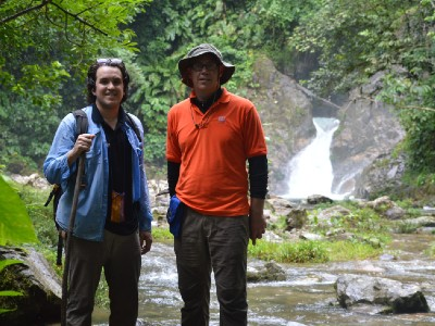 Men by waterfall