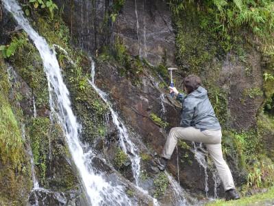 Man hammering into rock
