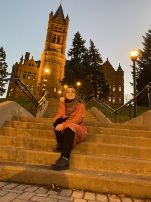 Nidaa Aljabbarin on the steps leading up to Crouse College on the Syracuse University campus