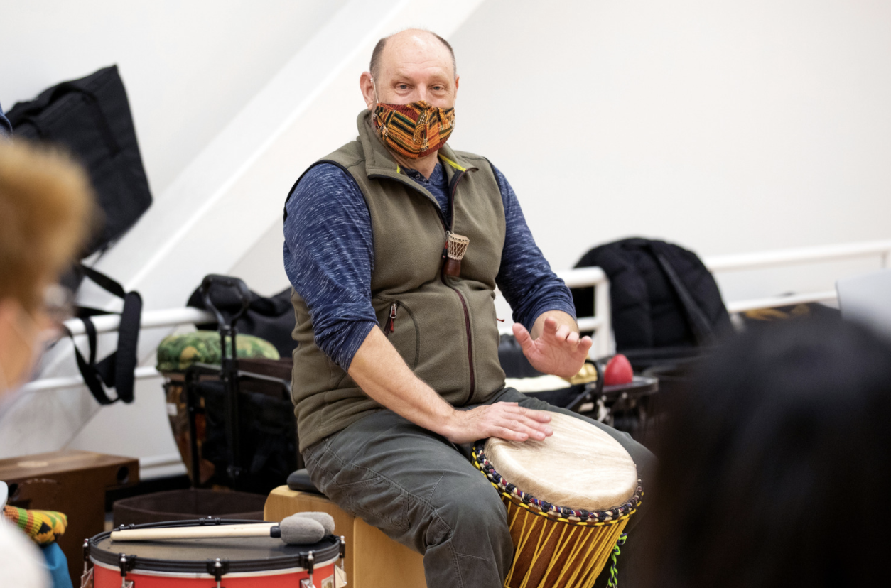 person drumming