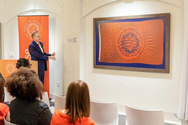 Chancellor presents Syracuse University flag