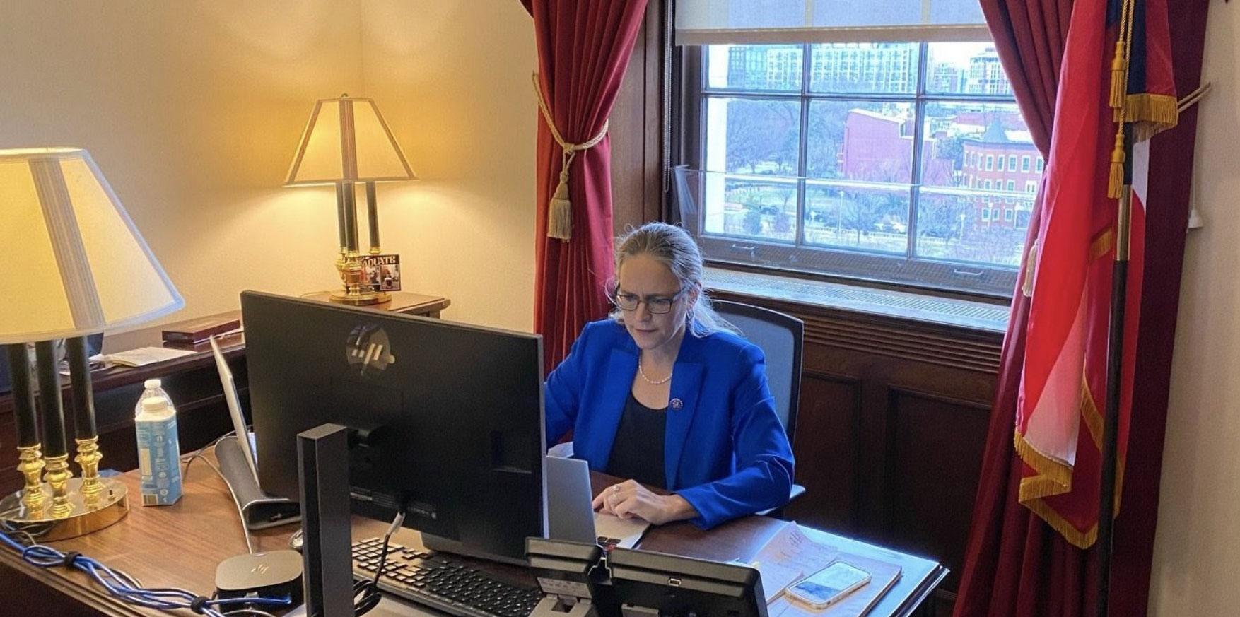 Carolyn Bourdeaux at her desk in her office