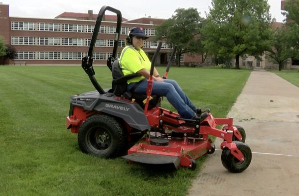 Electric lawn mower on the quad