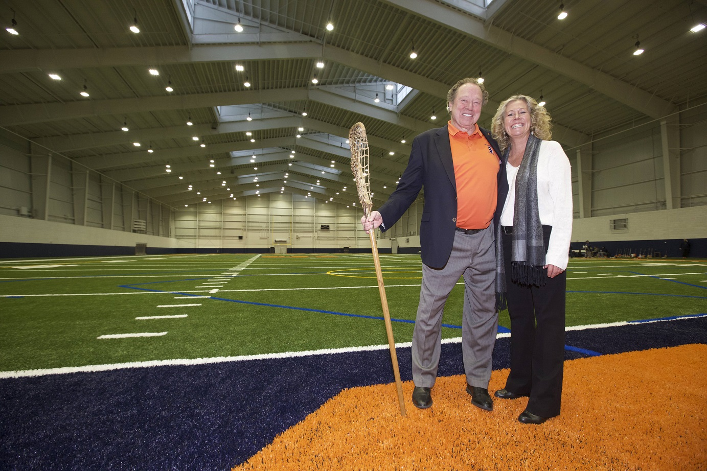 two people standing on athletic field