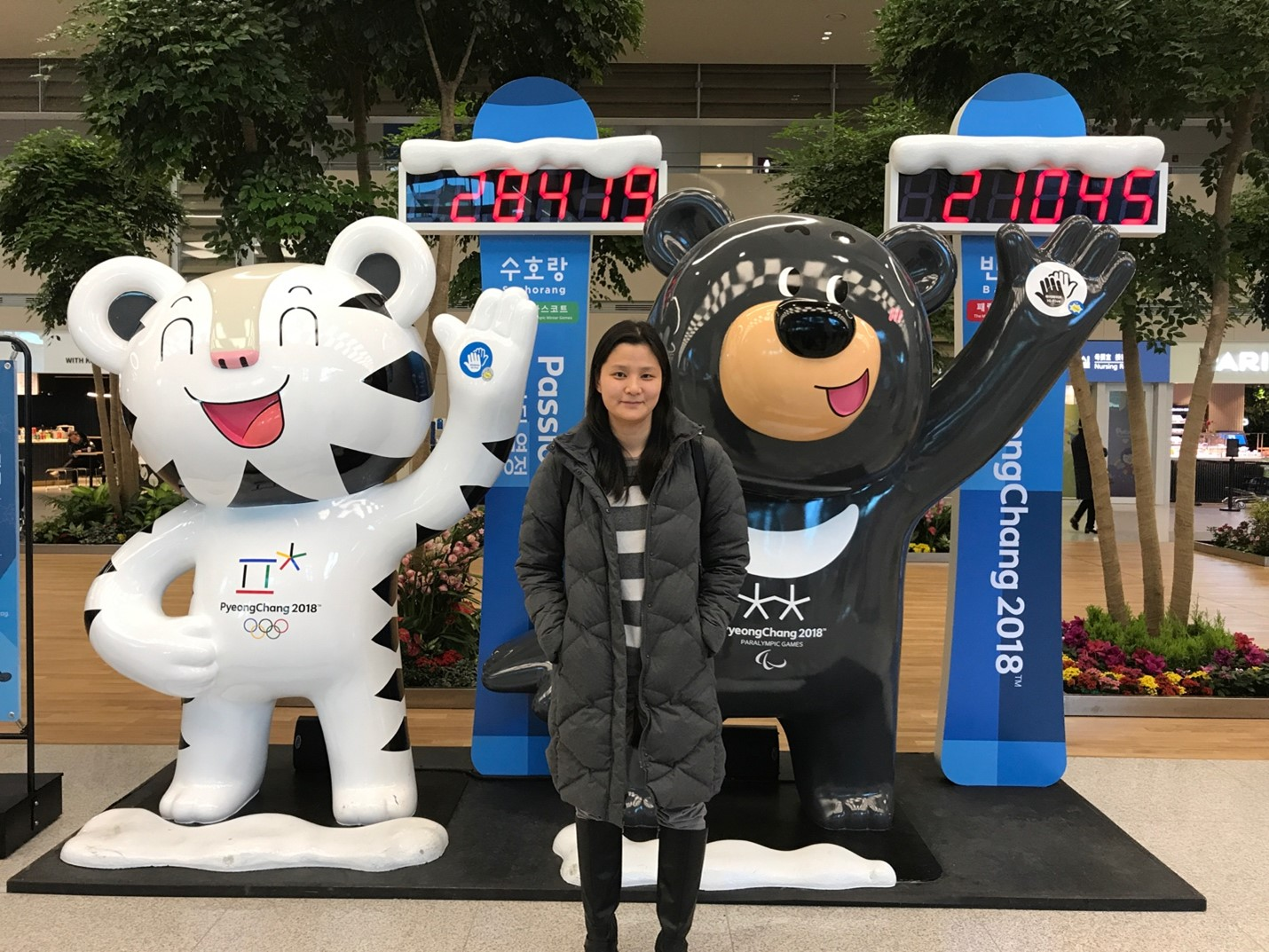 person standing in front of Olympic character