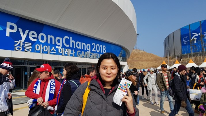 person standing in front of stadium