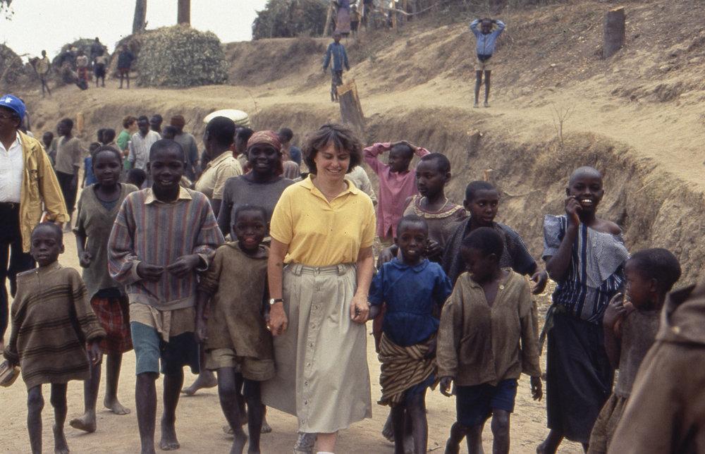 Professor Catherine Bertini with children in Rwanda in 1994