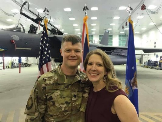 Lt. Col. Ryan Lippert and his wife in front of a plane