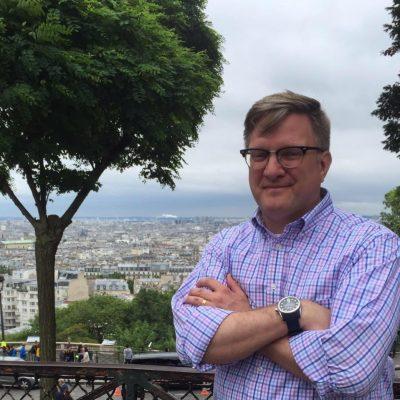 Professor Chuck Morris standing overlooking Paris