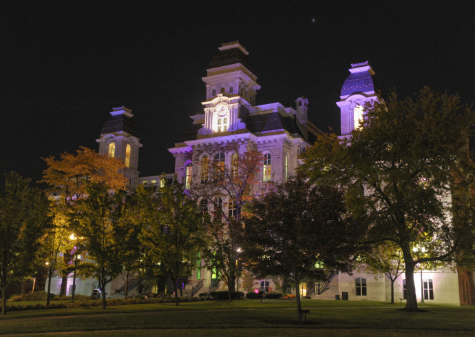 building lit up in purple at night
