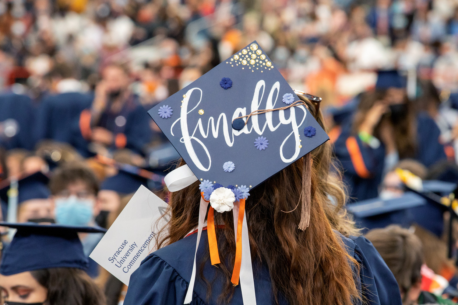 """a mortarboard adorned with the word """"Finally"""" on display at Commencement 2020"""