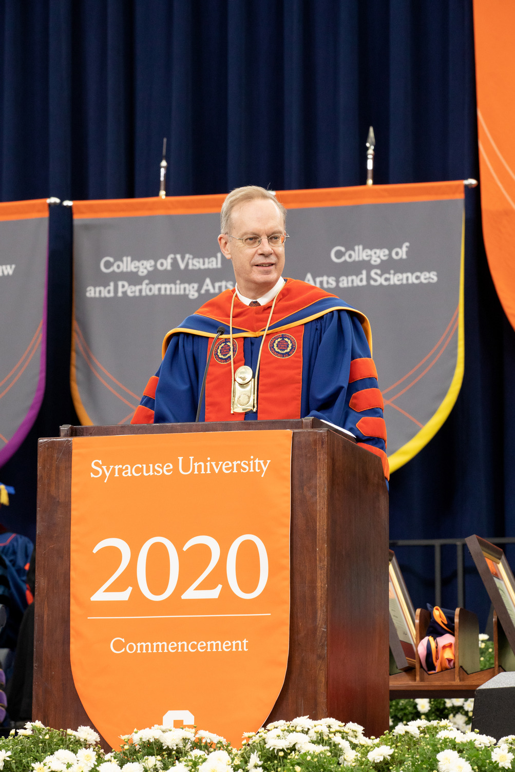 Chancellor Kent Syverud addresses the crowd from the podium at Commencement 2020