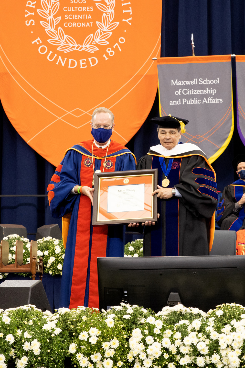 Chancellor Syverud presents an honorary doctor of humane letters degree to Daniel A. D'Aniello '68 at Commencement 2020