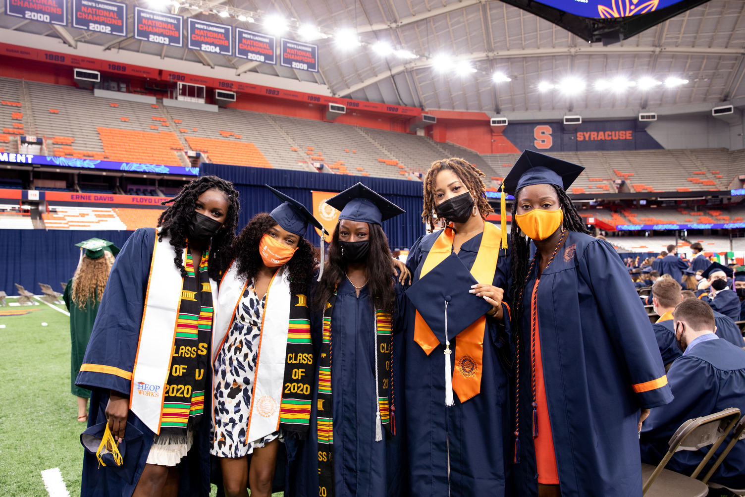 group of people in caps and gowns at 2020 Commencement, Sept. 19, 2021, in the stadium