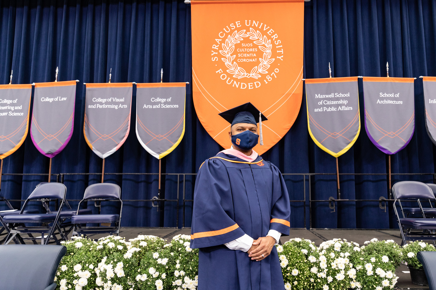 Kevin Richardson stands with hands folded in front of the stage at Commencement 2020